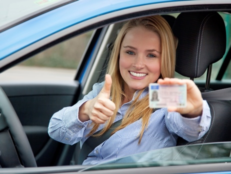 Smiling Girl with License